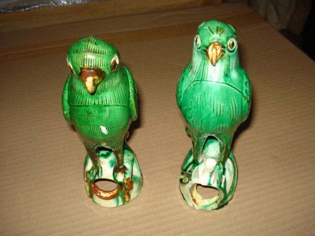 A pair of 19th Century pottery parrots