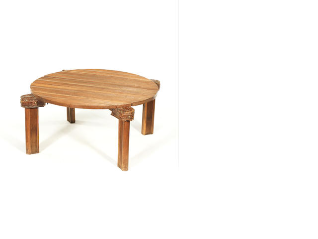 C 1155 Jacques Adnet A Coffee Table circa 1930  slatted oak and leather  Height: 37 cm.                14 9/16 in. Diameter of top: 72.5 cm.                         28 9/16 in.