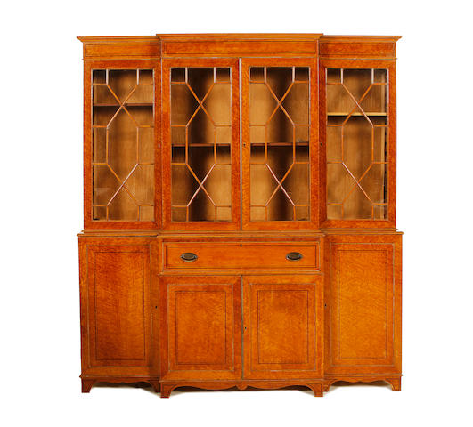 An Edwardian birds' eye maple breakfront secretaire bookcase