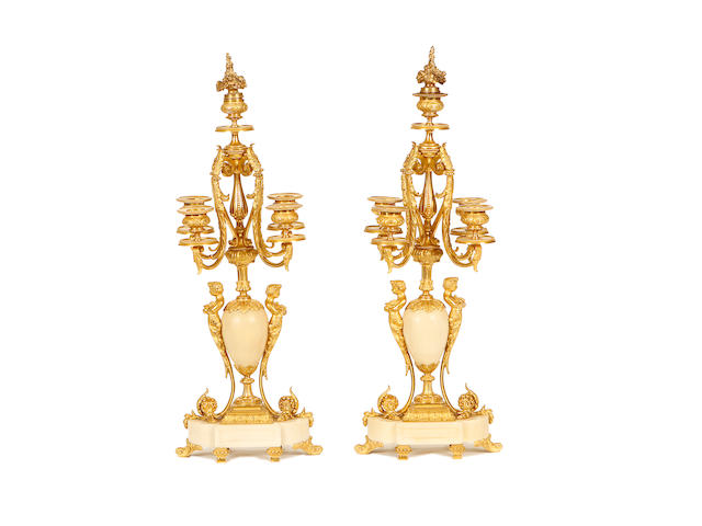 A pair of late 19th century Louis XVI style ormolu candelabra