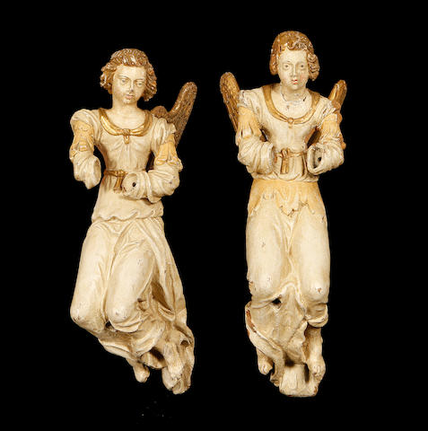A pair of late 18th / early 19th century painted and carved wood figures of angels