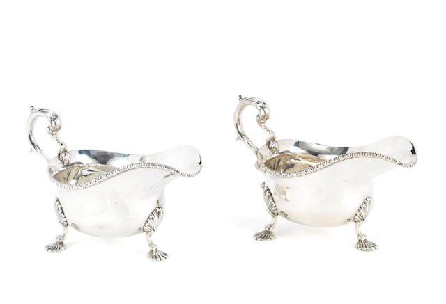 A pair of George III style silver sauceboats, by Edward Barnard & Sons, London 1940,  (2)
