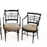 Three late 19th Century Aesthetic period ebonised Old English open armchairs