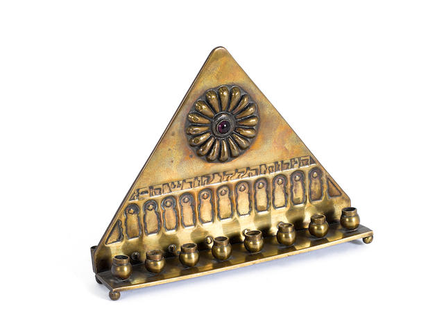 An unusual brass Hannukah lamp, by Bezalel, Jerusalem, together with nine further various items  (10)