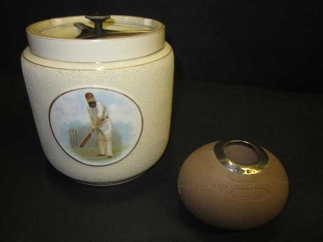 A Doulton rugby ball match-holder and a WG Grace biscuit barrel (2)