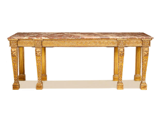 A large late 19th century carved giltwood serving table in the George II style
