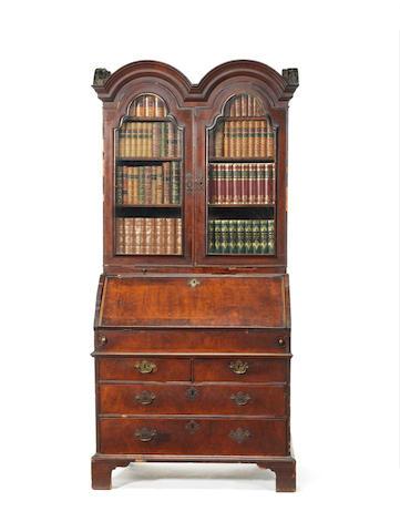 A Queen Anne walnut double-dome bureau bookcase