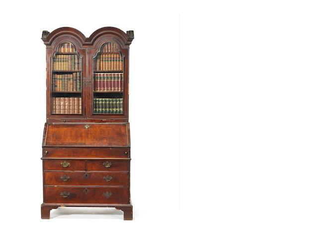 A George I walnut bureau cabinet