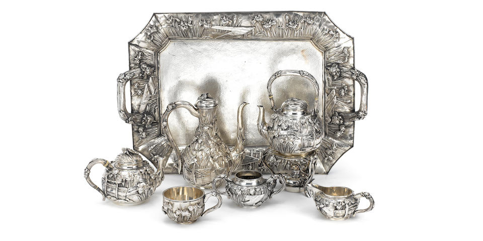 An impressive early 20th century Japanese silver six-piece tea and coffee service together with a two-handled tray, with character marks only,  (8)