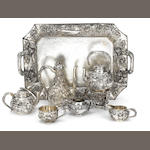 An impressive early 20th century Japanese silver six-piece tea service and tray,   with character marks only,   (8)