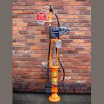 A Gilbert & Barker hand operated petrol pump,