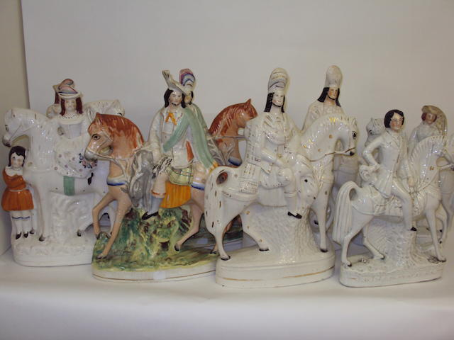 Four pairs of large equestrian Staffordshire figures