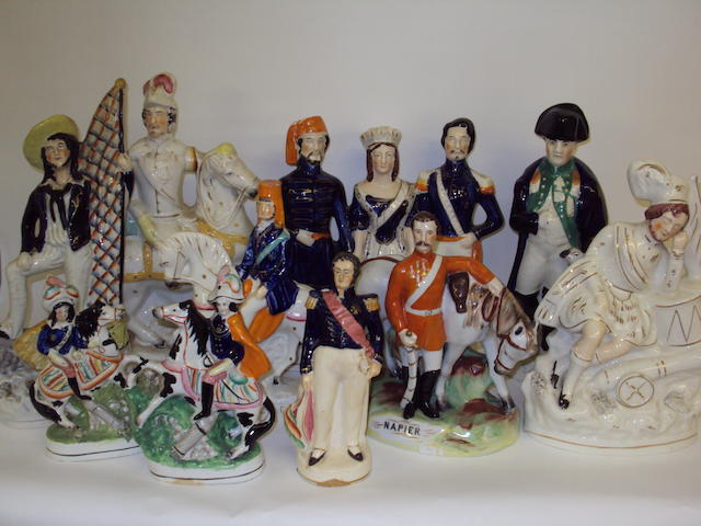 A collection of Staffordshire military figure groups