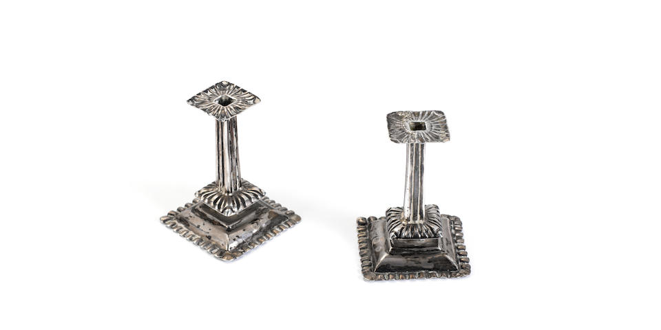 A pair of second quarter of 18th century silver miniature candlesticks,makers mark, a leaf, Delft, with later tax marks