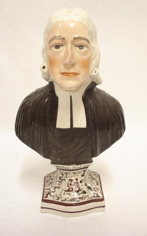 A Staffordshire creamware bust of John Wesley