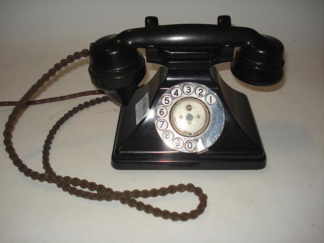 Mostly pre-war 200-series telephones: main sets and extension bodies, black bakelite;