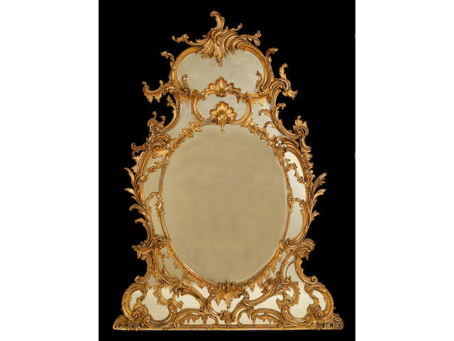 A large 19th century carved giltwood overmantel mirror in the Rococo revival style