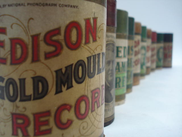 A collection of 2-minute phonograph cylinders and black Amberols