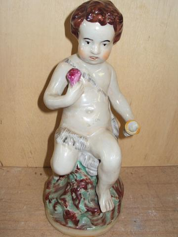 A Staffordshire figure of a young boy