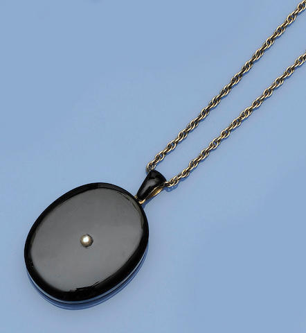 A mourning locket and chain,