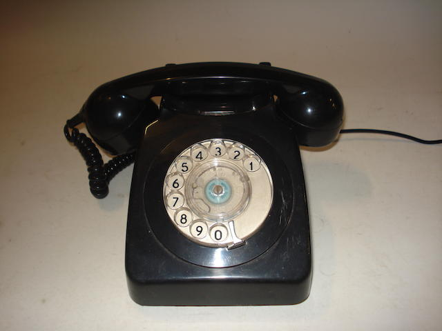 A large selection of 700-series telephones: various colours,