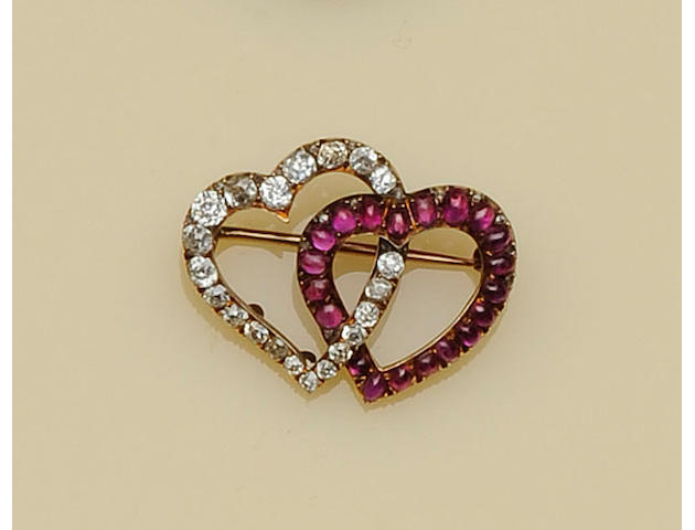 A Russian ruby and diamond double heart brooch