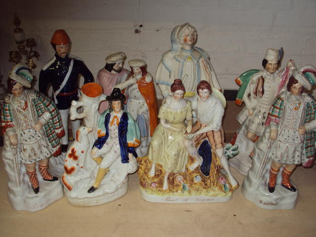A collection of Staffordshire flatback figures