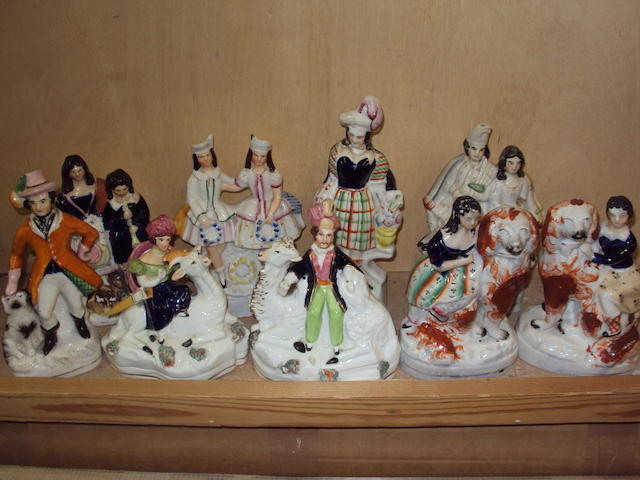A collection of Staffordshire figures