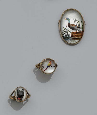 A late 19th century reverse carved rock crystal intaglio brooch and two late 19th century reverse carved rock crystal intaglio rings (3)