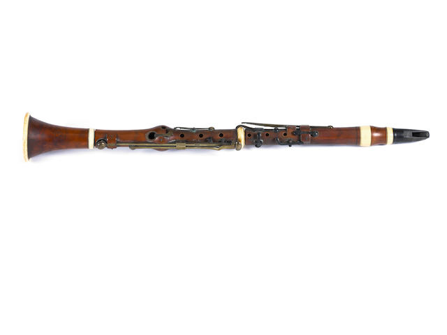 A boxwood & ivory Clarinet by Wood & Sons, Compton, 50 Soho, London , with recorder