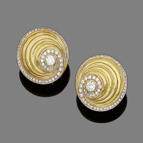 A pair of gold and diamond earrings, by de Vroomen,
