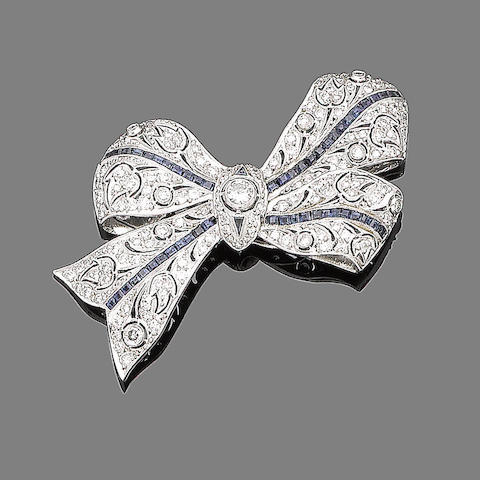 A sapphire and diamond bow brooch