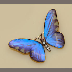 An Austrian gold mounted diamond set butterfly brooch