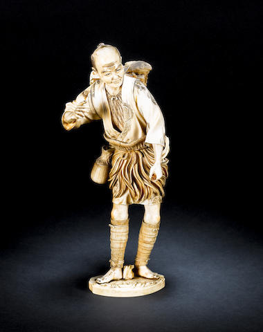 A sectional ivory okimono of a fisherman Meiji Period