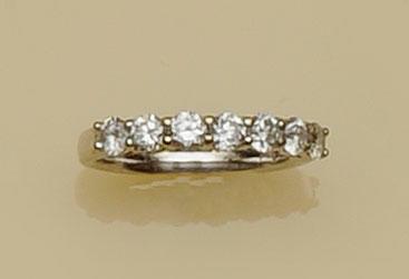 A diamond half hoop eternity ring
