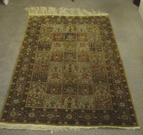 A silk Benlian Tabriz rug