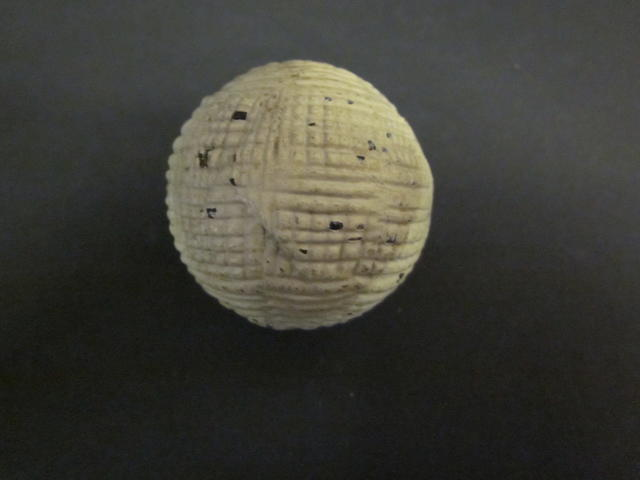 An Alex Patrick gutty golf ball circa late 1870s