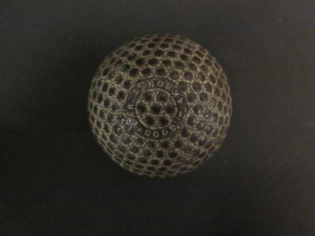A Giepel and Lange Pneumatic bramble patterned golf ball