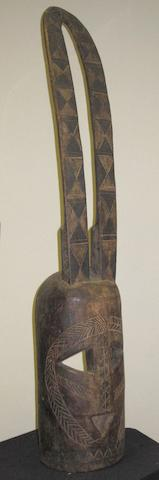 A Mossi mask, Burkina Faso, 89cm high