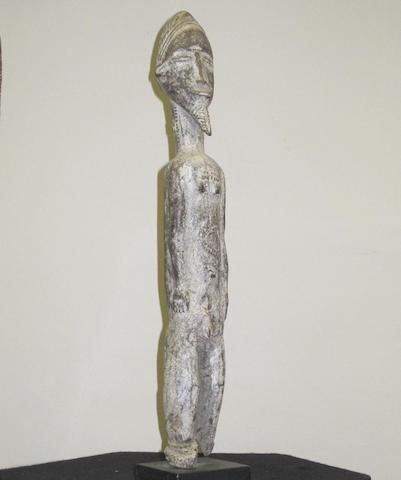 A Baule trance diviner's Asye Usu figure, Ivory Coast, 41cm high