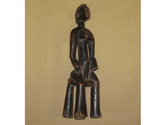 A Senufo sandobele divination figure, Ivory Coast, 24cm high