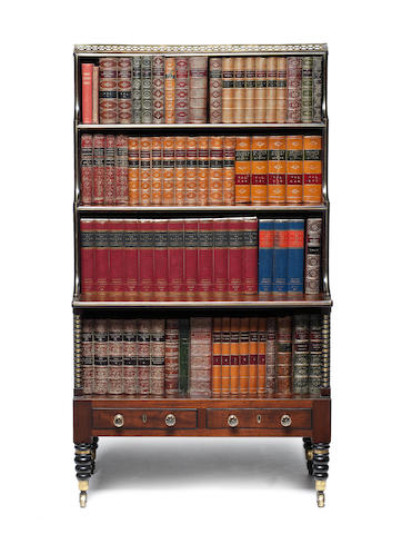A Regency mahogany, ebonised and brass mounted waterfall bookcase
