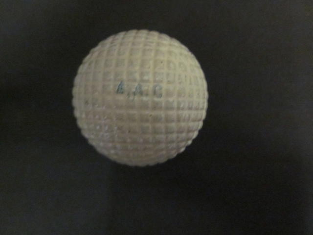 Six 'Silver Town 27½ No.4' moulded mesh gutta-percha white golf balls