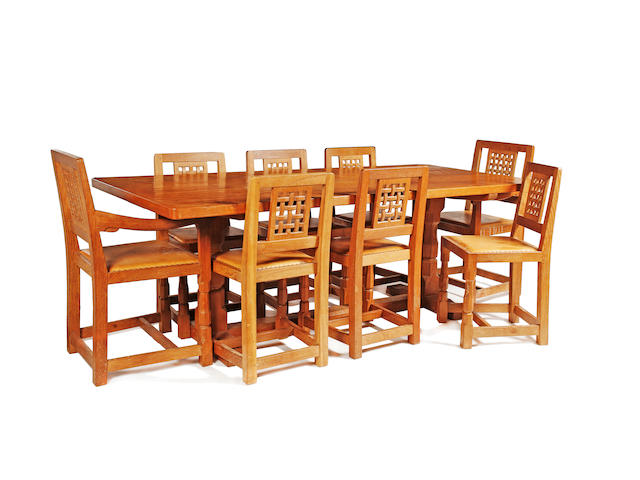"By Robert ""Mouseman"" Thompson of Kilburn: An oak dining table and eight chairs"