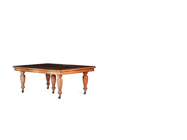 A late Victorian mahogany five-leaf telescopic dining table and leaf holder, fourth quarter 19th century