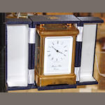 A 20th Century gilt brass carriage clock  with blue fitted case and winder