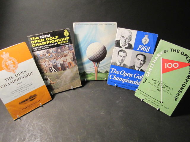 A selection of golf programmes and small sized golf balls