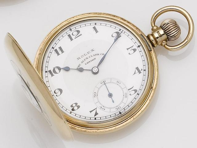 Rolex. A 9ct gold half hunter manual wind pocket watch Retailed by 'The Alex Clar Company', Birmingham hallmark for 1930