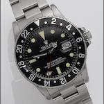 Rolex. A stainless steel automatic calendar bracelet watch with 24-hour bezel  GMT Master, Ref: 1675, Serial No. 1437527, 1960's