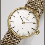 Omega. A lady's 9ct gold bracelet wristwatch1960's